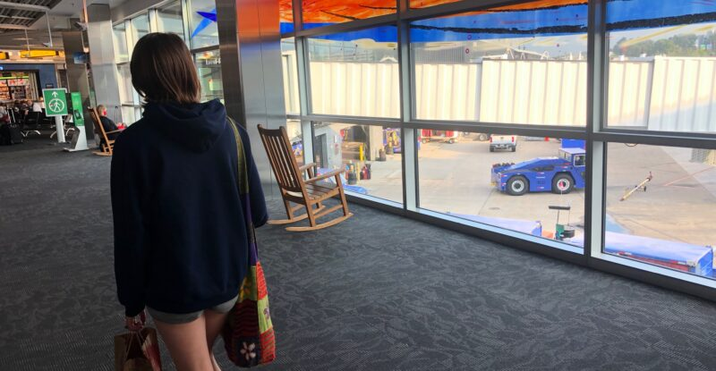 female passenger walking in the airport