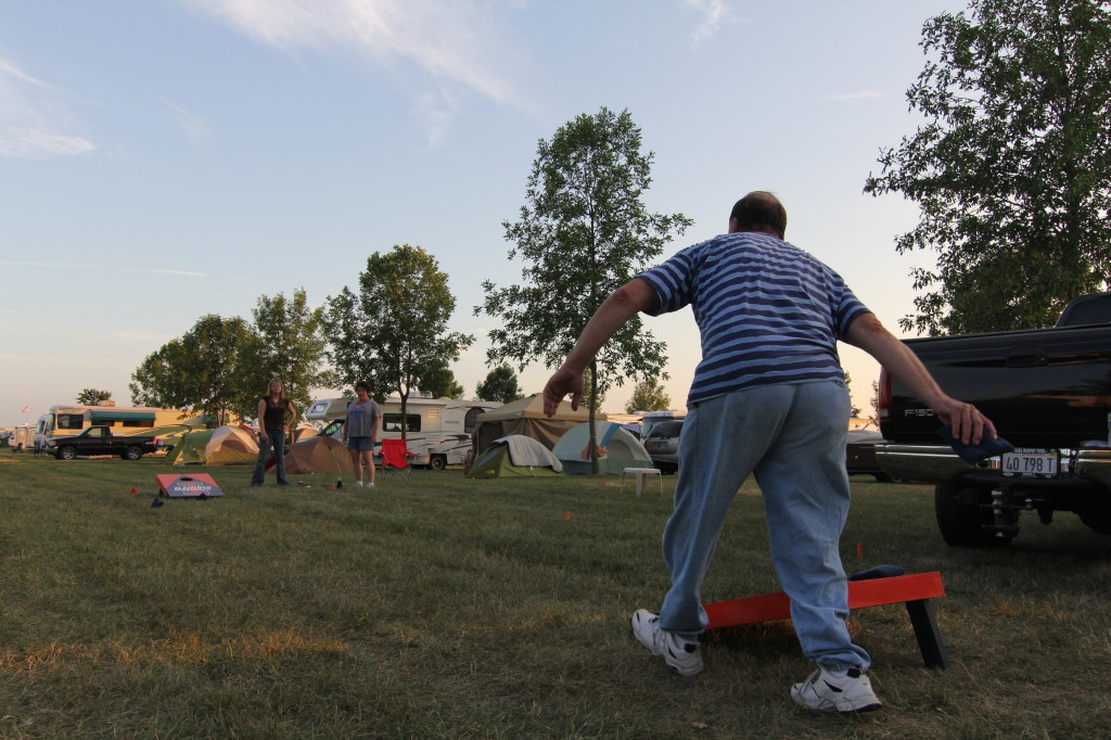 Denny Talbott enjoys a game of bags at his campsite in Camp Scholler.