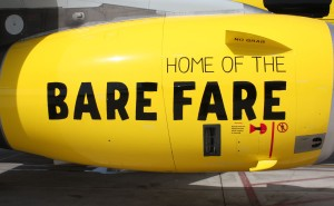 Spirit bare fare text as livery on the side of the bright yellow aircraft engine