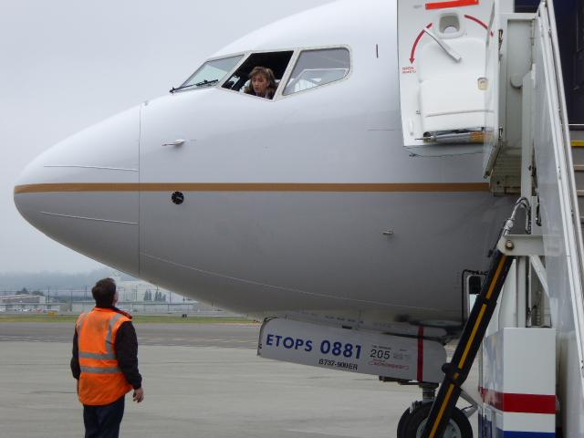Capt. Kim Noakes discusses flight details with ground crew