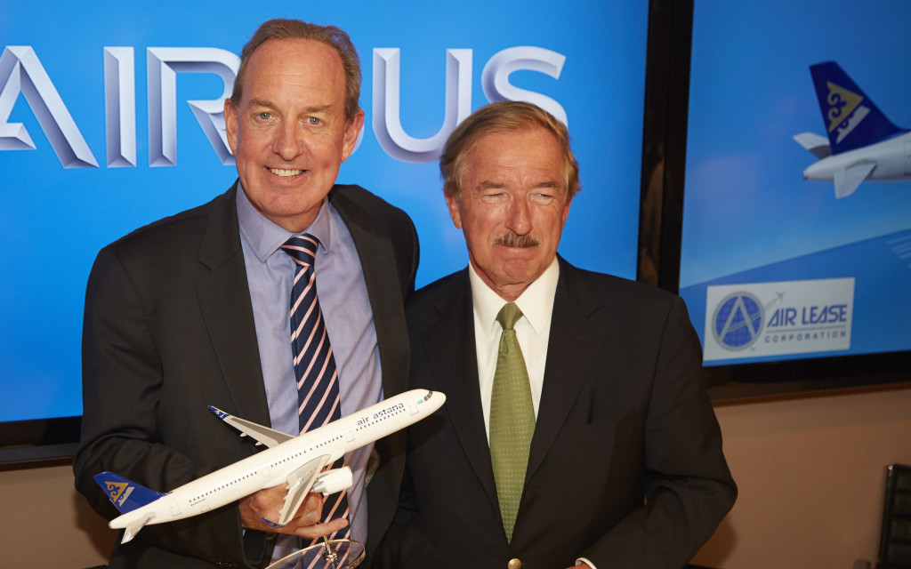 L-R Peter Foster CEO and President, Air Astana , signs for seven Airbus A320neos at Paris Air show with Steven Udvar-Házy, Chairman and Chief Executive Officer, Air Lease Corporation
