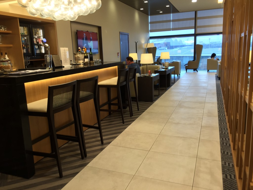 High-backed chairs and a staffed bar feature in the business lounge