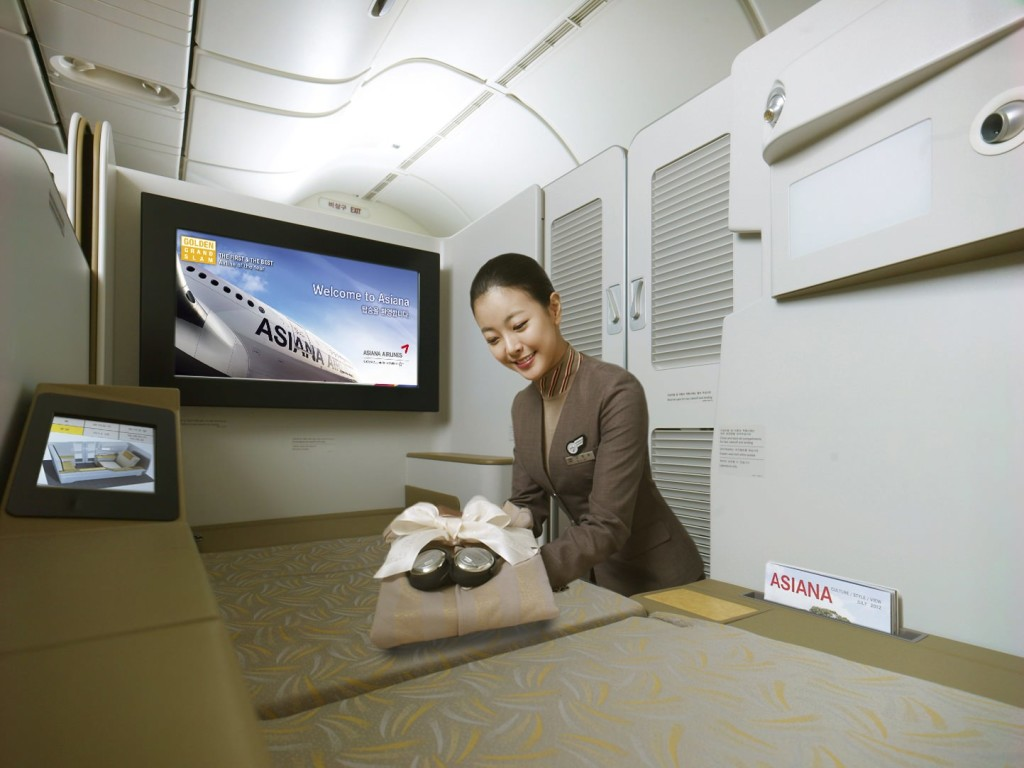 The strangely Photoshopped cabin crewmember is not included with every Asiana suite, although the nauseating seat pattern unfortunately is.
