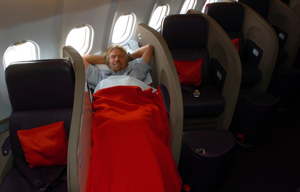 RIchard Branson, not a large man, highlights the narrow problem with the smaller A340 seat