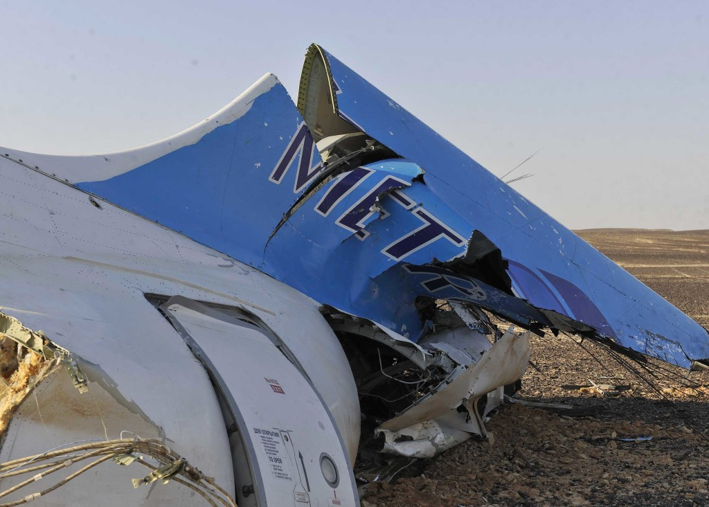 This image released by the Prime Minister's office shows the tail of a Metrojet plane that crashed in Hassana Egypt, Friday, Oct. 31, 2015. The Russian aircraft carrying 224 people, including 17 children, crashed Saturday in a remote mountainous region in the Sinai Peninsula about 20 minutes after taking off from a Red Sea resort popular with Russian tourists, the Egyptian government said. There were no survivors.(Suliman el-Oteify, Egypt Prime Minister's Office via AP)