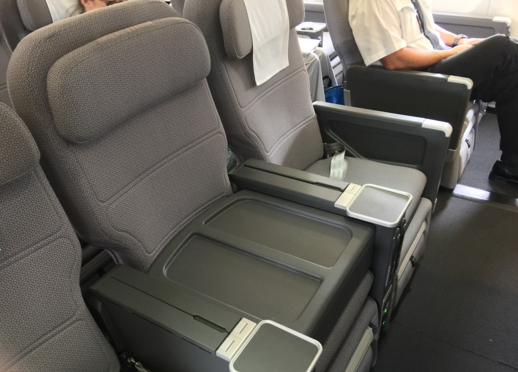 With the middle seat of three blocked off, these international premium economy seats become domestic business