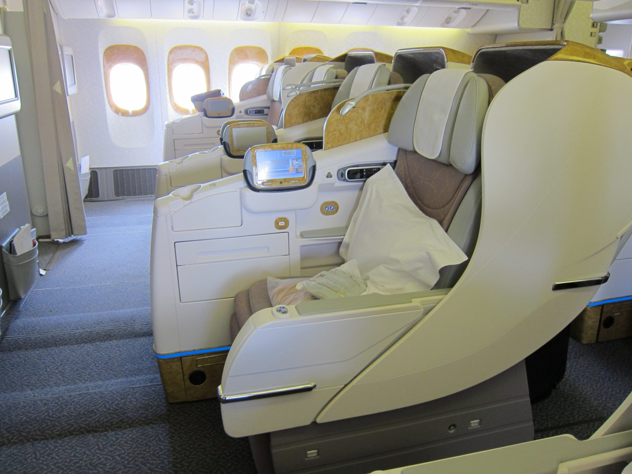 The passengers next to the aisles on Emirates' 2-3-2 777 layout get very little protection from passing%2