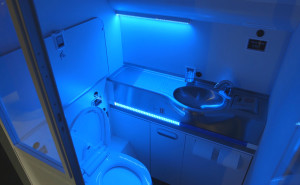 Boeing's self-cleaning lav includes UV light. This image shows blue light bathing an onboard lavatory
