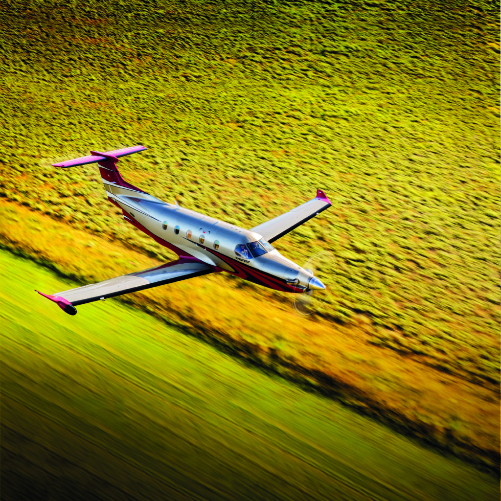 Aerial photography of the Pilatus PC-12 NG flying over Smiley Creek Airport (U87) near Ketchum, ID. Whether it is the large cabin, single pilot operations, long range, low operating costs, high speed, short-field capability, or precision Swiss engineering and construction, customers find the perfect balance of features to serve their needs in the PC-12 NG. Smiley Creek Airport (U87) Ketchum ID USA