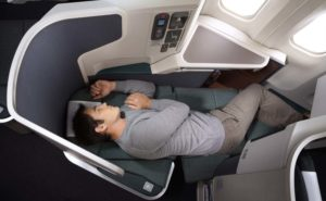 Cathay passenger sleeping lie-flat without a mask in business