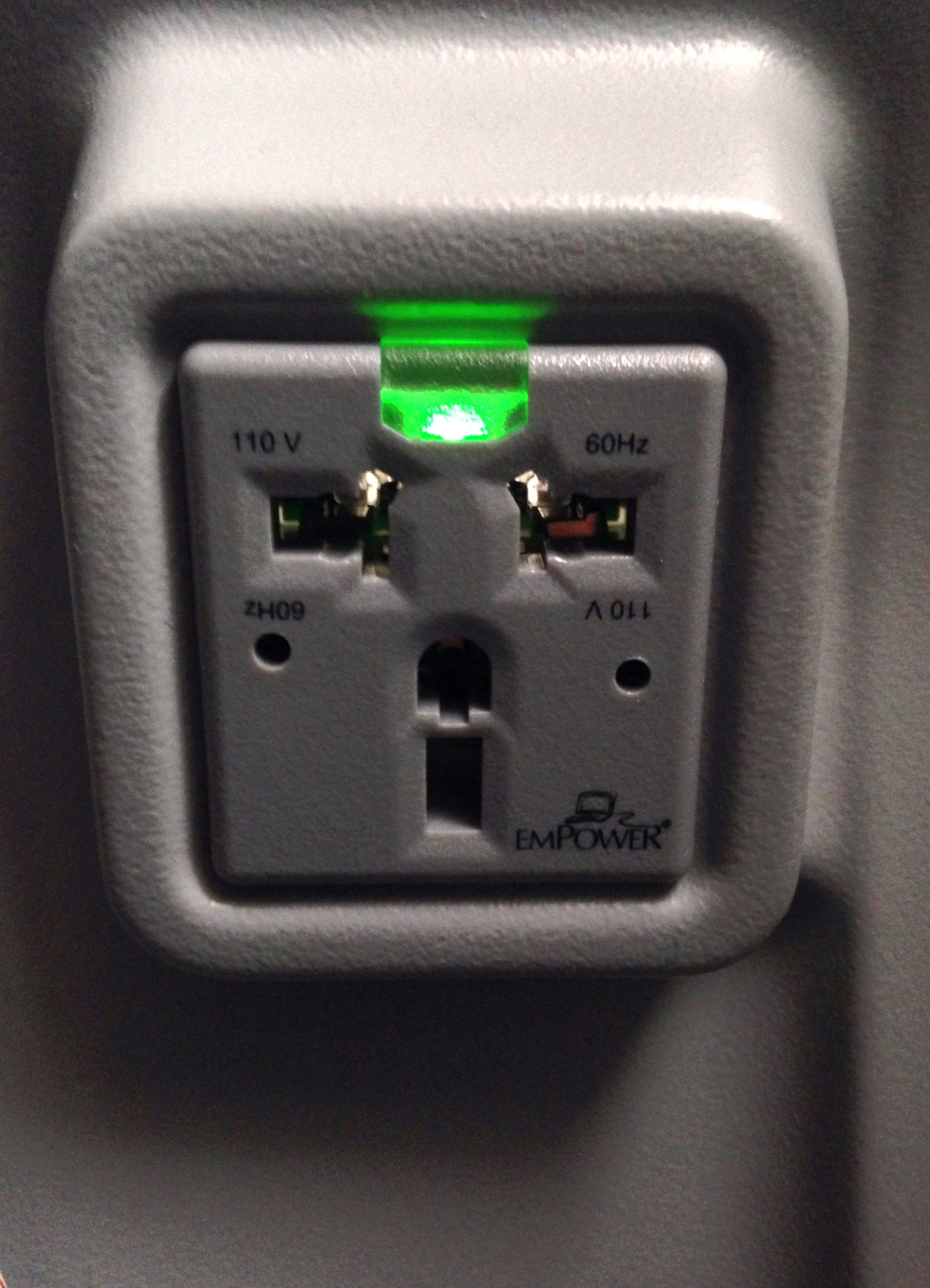 A airplane seat back plug face. Image: Astronics