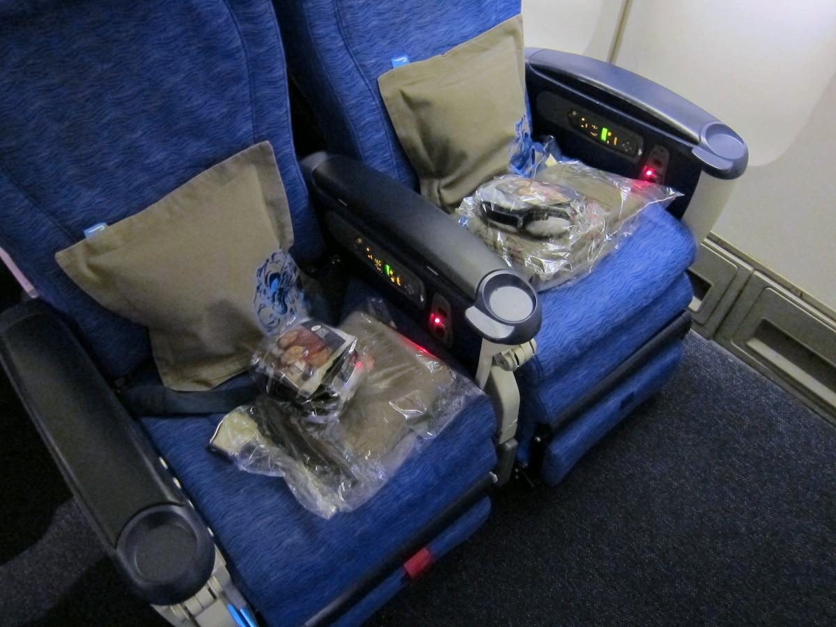 BA's relatively small 747 World Traveller Plus seats haven't been upgraded to the current standard. Image: John Walton