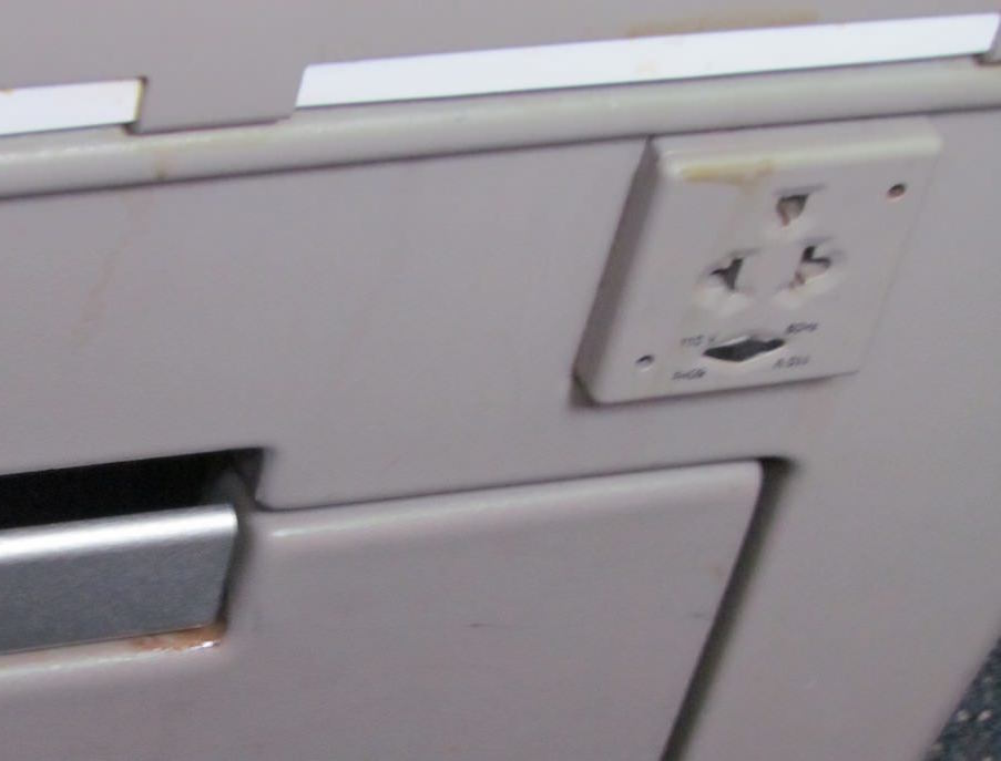 Dirt and grime aside, the worst part of the old Club World seats was the non-UK power socket. Image: John Walton
