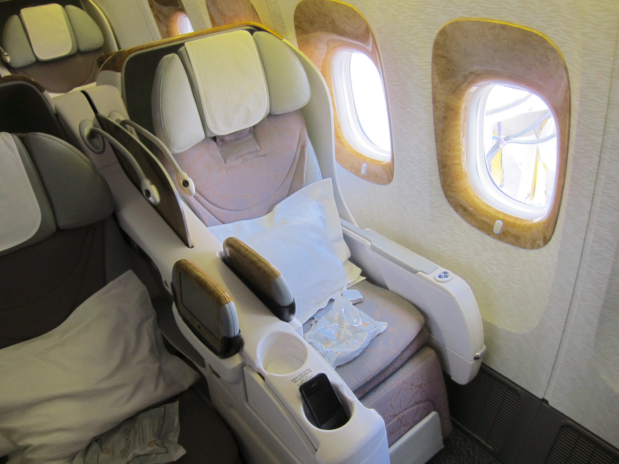 Emirates' existing 777 business class is narrow and in a 2-3-2 layout. Image: John Walton