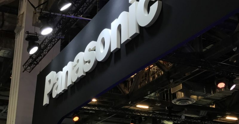 Panasonic sign with black background and white lettering, saying Panasonic