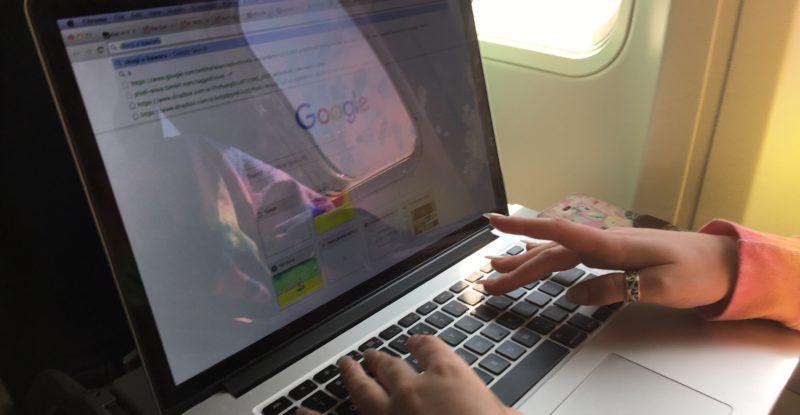 Girl using a laptop in-flight
