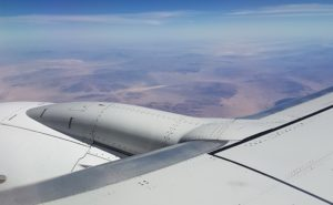 aircraft in flight representing aircraft emissions