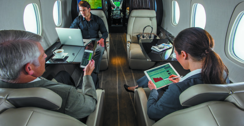 Passengers aboard a business aircraft, using SmartSKy's IFC service via their tablets