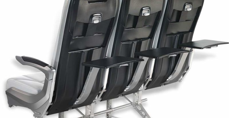 3 slimline aircraft seats view from the back with tray tables opened