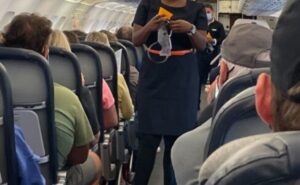 Flight attendant gives safety briefing onboard