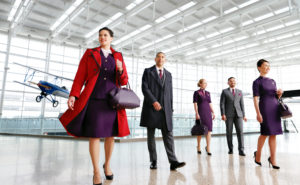 Group of flight attendants wearing a variety of uniform options and featuring the women's trench coat. Image: Delta Air Lines