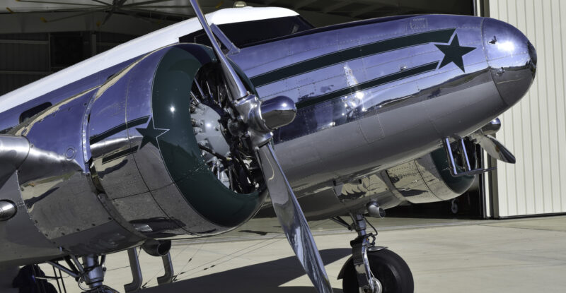 Vintage, silver-colored, all-metal airplane popular as an airliner in the 1930s.