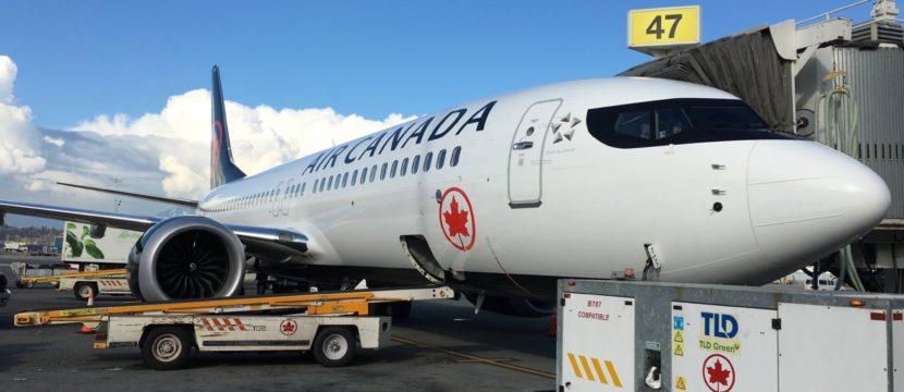 Air Canada MAX parked at gate