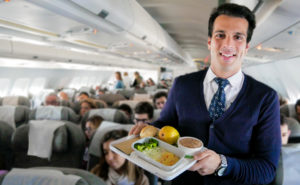 hi fly cabin crew serving a meal onboard