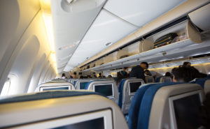 interior of the aircraft cabin seats and overhead bins open
