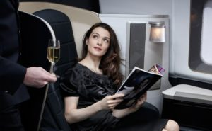 woman being served champagne on airplane