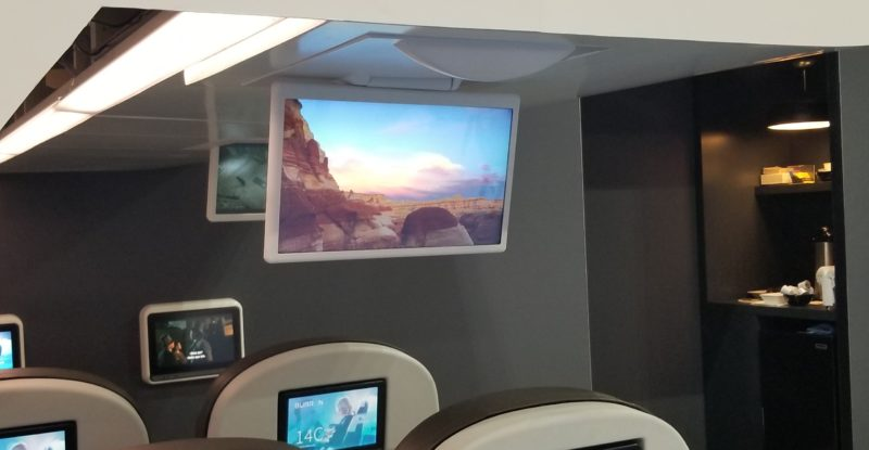 Large overhead screen on aircraft, supplied by Burrana