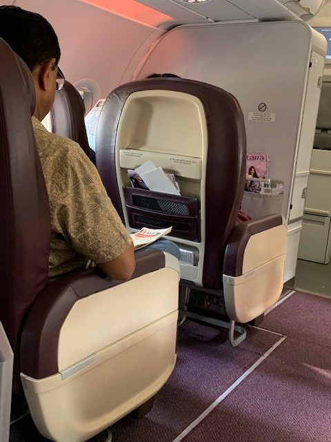 A passenger seated in a Vistara business class seat