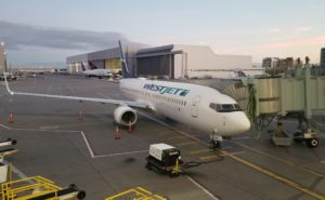 WestJet Boeing 737-800 aircraft at gate in Toronto Canada