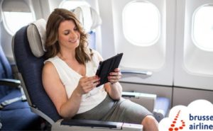 Woman looking at tablet inside an aircraft