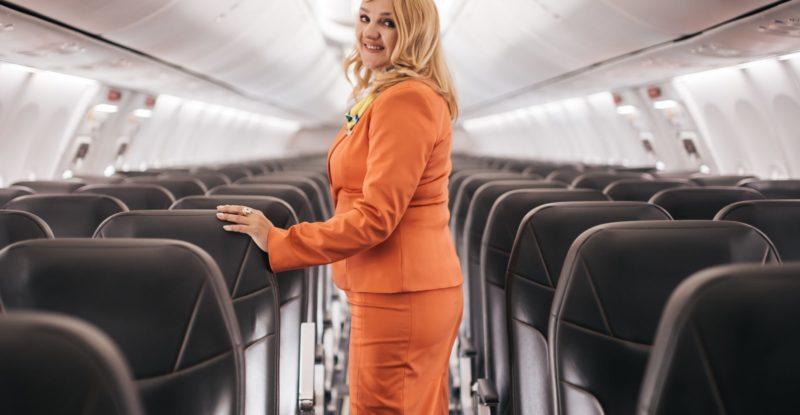 SkyUp flight attendant with Acro Series 3 ulta airplane seat