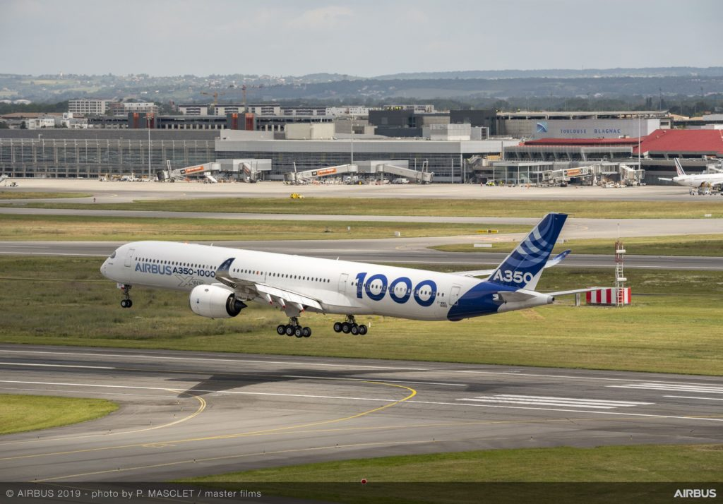 A350-1000 taking off on a runway