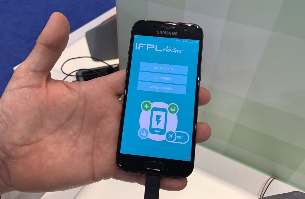 Hand holding a phone demonstrating the IFPL model