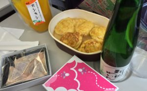 An airline meal tray with bottle of champagne