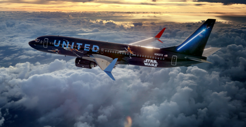 United Airlines aircraft in a sunny cloudy sky