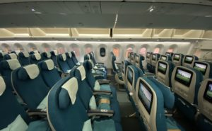 Interior of the aircraft. Economy seating with IFE screens