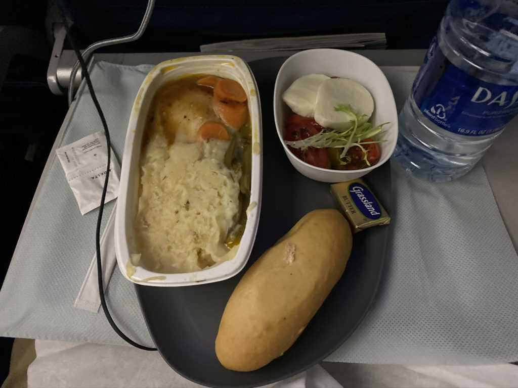 inflight meal bread and entree on tray table