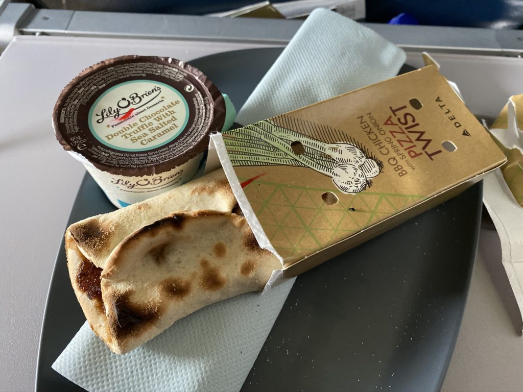 Pizza Twist snack offered and displayed on tray table