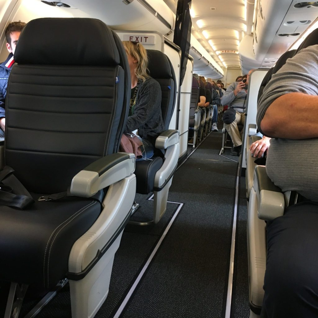 people sitting in crj550 aircraft
