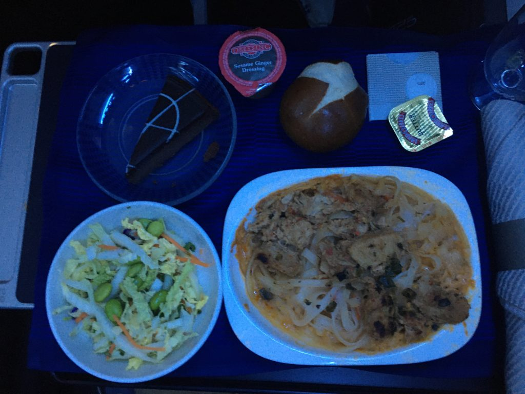 meal service on an aircraft, meal sitting on seat tray table