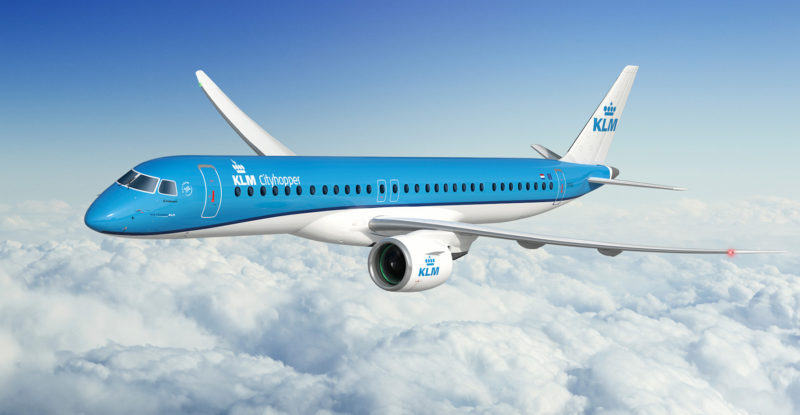 klm cityhopper aircraft in the clouds
