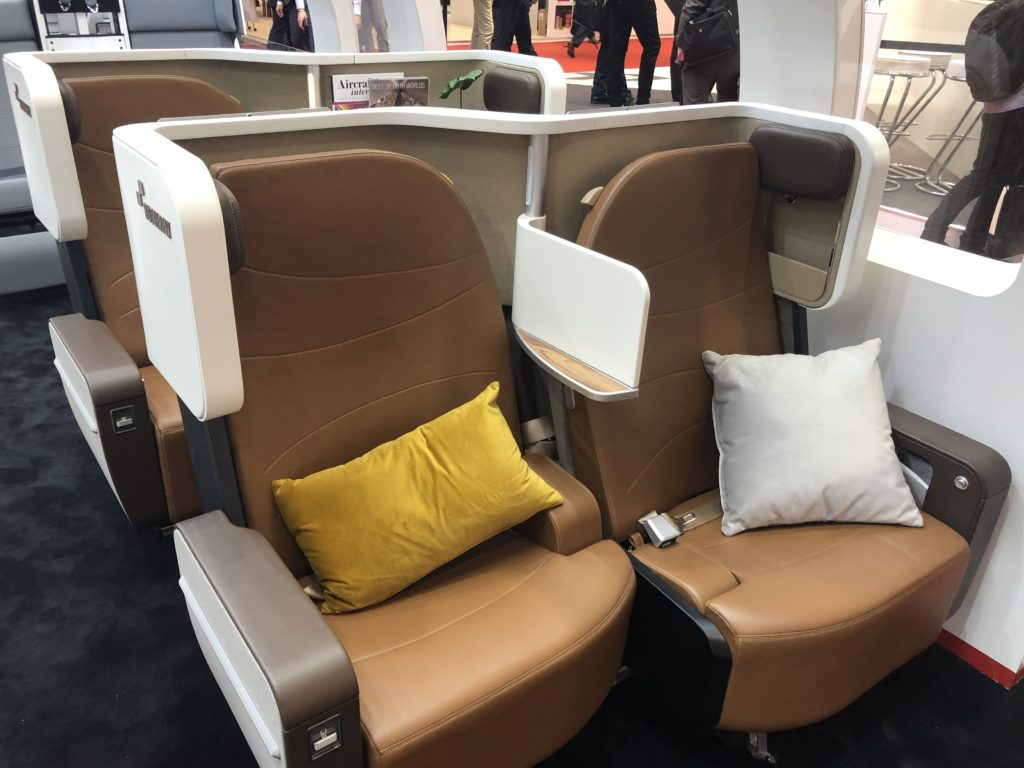Two business class seats with brown Ultraleather