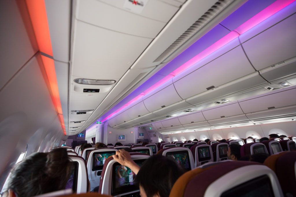 interor of aircraft with led lighting and ife screens in seatbacks