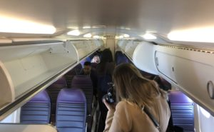United CRJ550 interior with woman taking a photo
