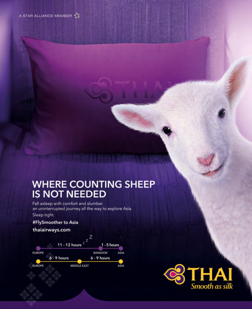 Thai Airways purple pillow on purple aircraft seat with a sheep poking its head out