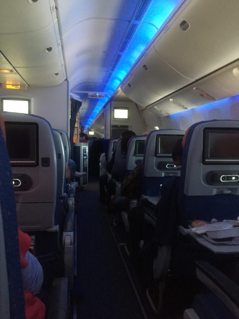 interior of aircraft cabin in Economy class